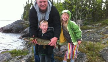 Family fishing at Milton Lake Lodge Saskatchewan.