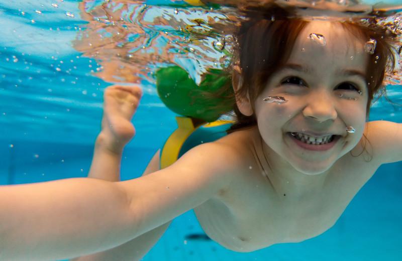 Kid swimming at Maui Sands Resort & Indoor Waterpark.