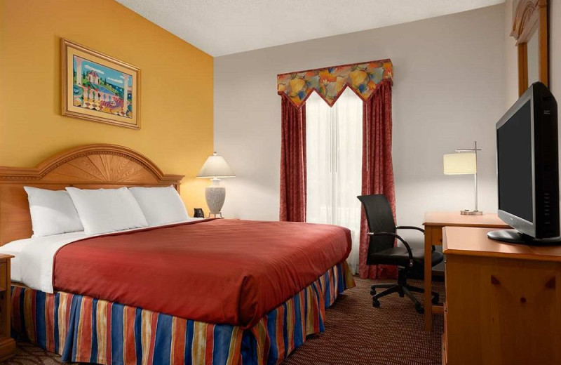 Guest room at Homewood Suites by Hilton Ft. Myers Bell Tower Hotel.