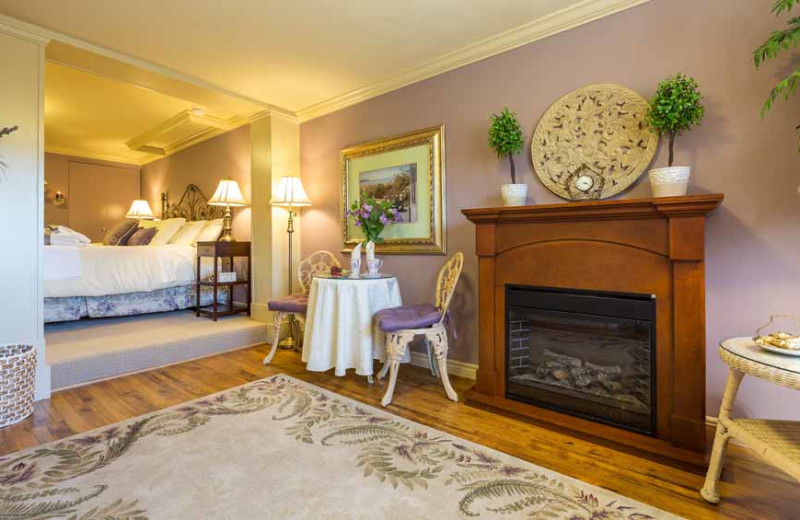 Guest room with fireplace at A Vista Villa Couples Retreat.