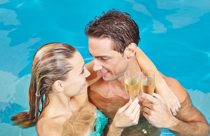 Couple in pool at A Vista Villa Couples Retreat.