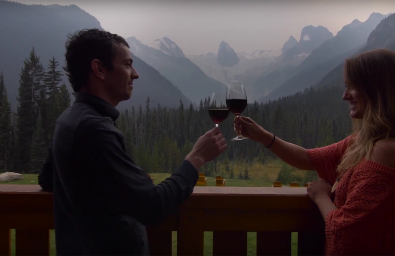 Couple toasting at Bugaboos Lodge.