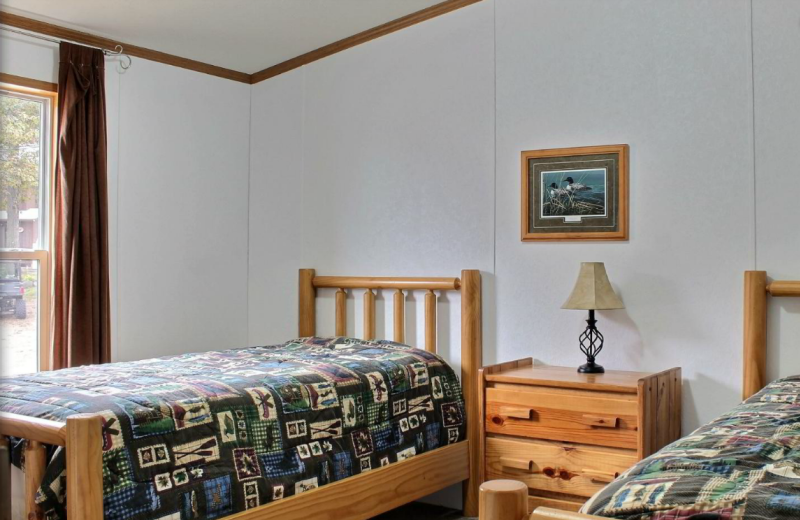 Cabin bedroom at Whaley's Resort & Campground.