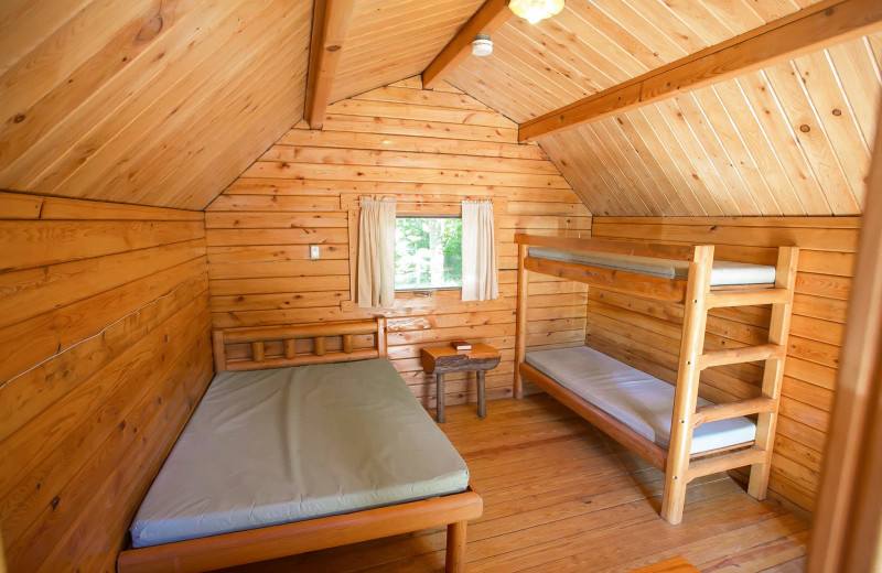 Cabin bedroom at Old Forge Camping Resort.