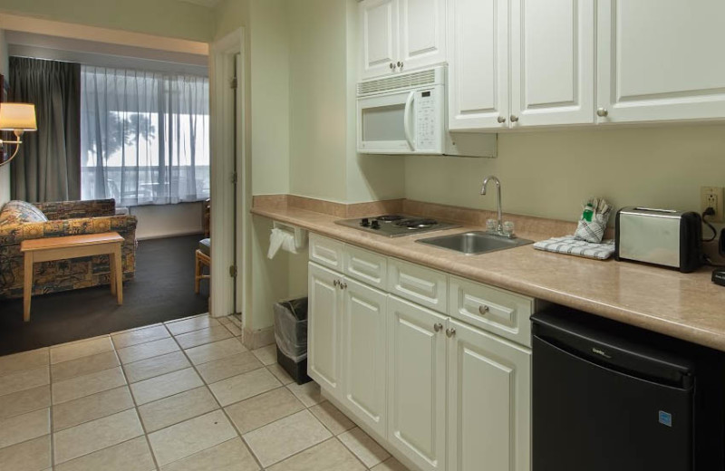 Guest kitchen at Days Inn & Suites Jekyll Island.