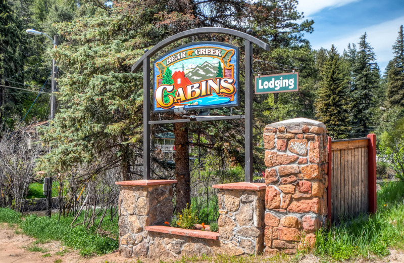 Sign for Colorado Bear Creek Cabins.