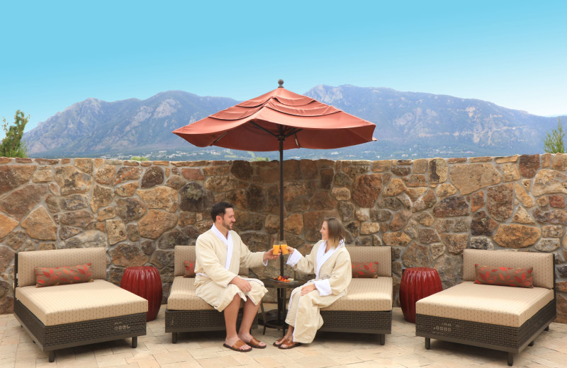 Private outdoor relaxation patio with mountain views at Alluvia Spa & Wellness Retreat, Cheyenne Mountain Resort's on-site spa.