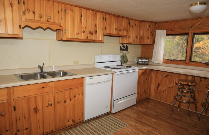 Cabin kitchen at Timber Trail Lodge & Resort.