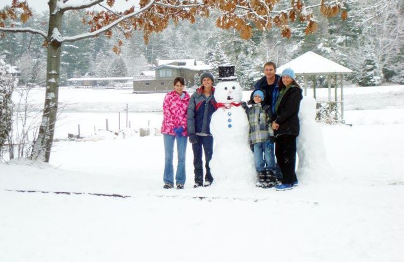 Building a snowman at Wildwood on the Lake.