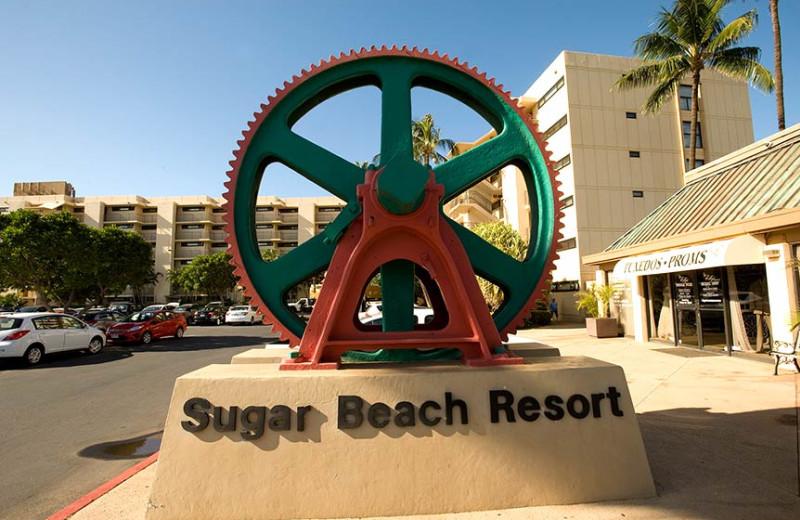 Sugar Beach Resort sign.