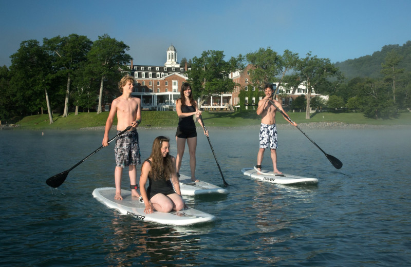 Family paddle boarding at The Otesaga Resort Hotel.