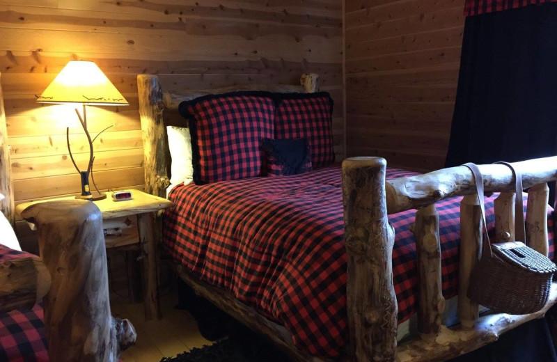 Cabin bedroom at Favorite Bay Lodge.