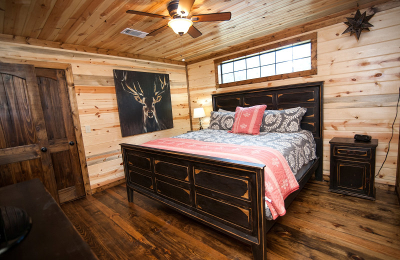 Cabin bedroom at Kiamichi Country Cabins.