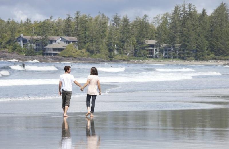 Couple on beach at Wickaninnish Inn.