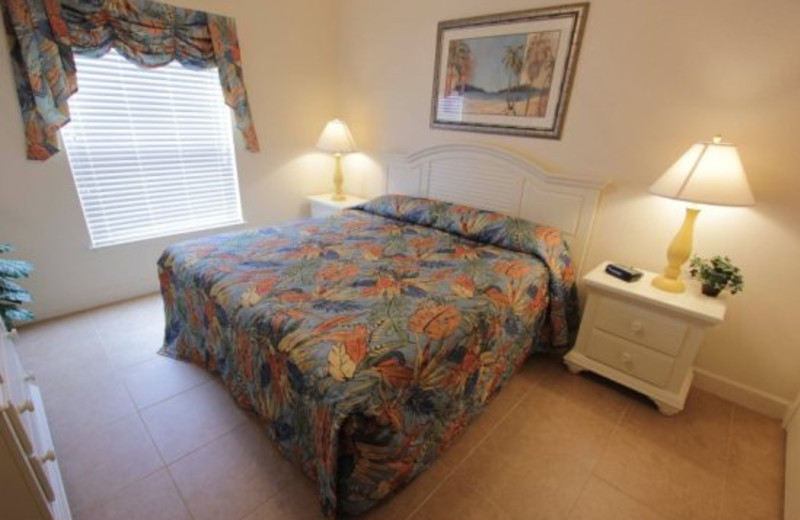 King size bed master suite at Elite Vacation Homes.