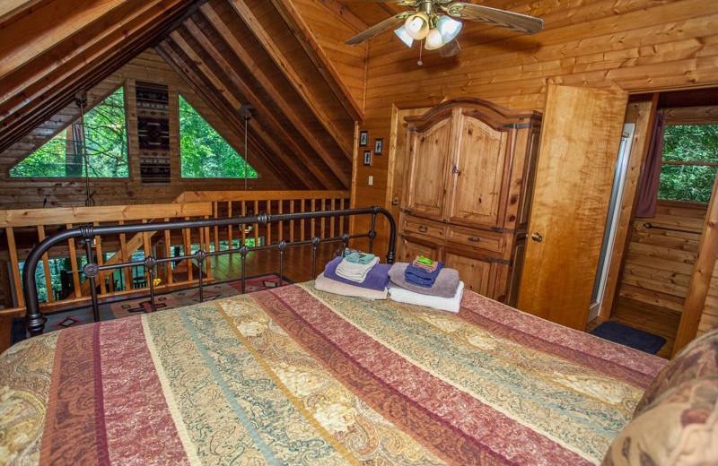 Rental loft bedroom at Blue Sky Cabin Rentals.