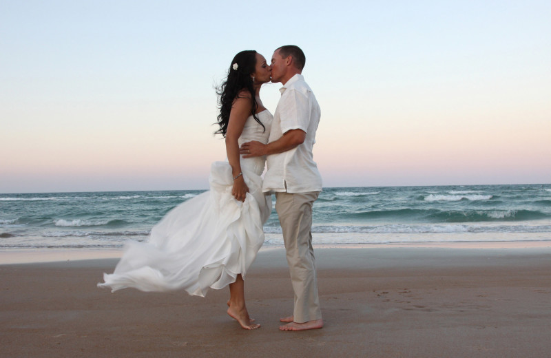 Wedding couple on beach at Coral Sands Oceanfront Resort.