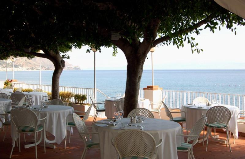 Patio dining at Hotel Lido Méditerranée.