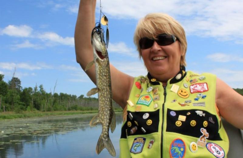 Lady With Fish at Janetski's Big Chetac Resort
