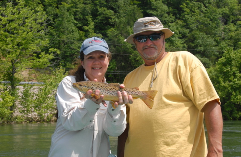 Couple fishing at The White River Inn.