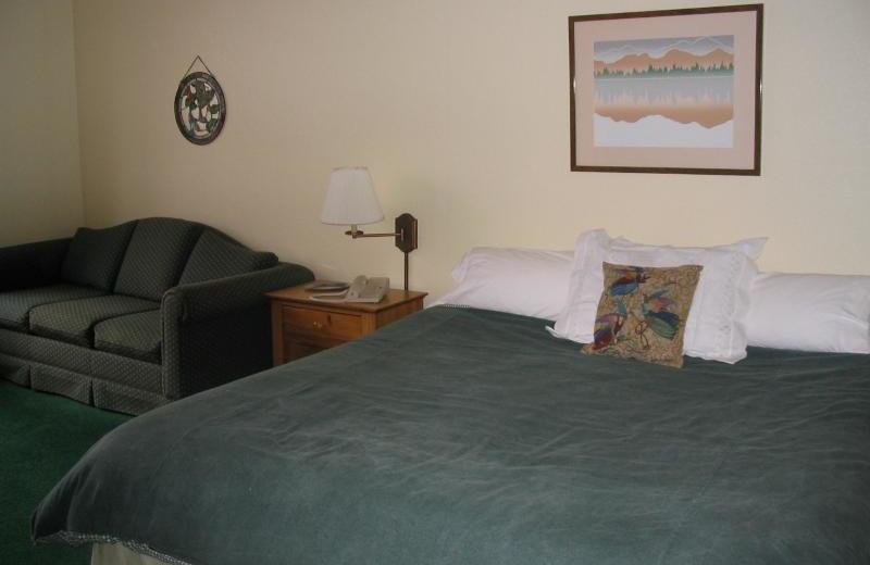 Condo bedroom at Cabin exterior at Lori's Luxury Rentals.