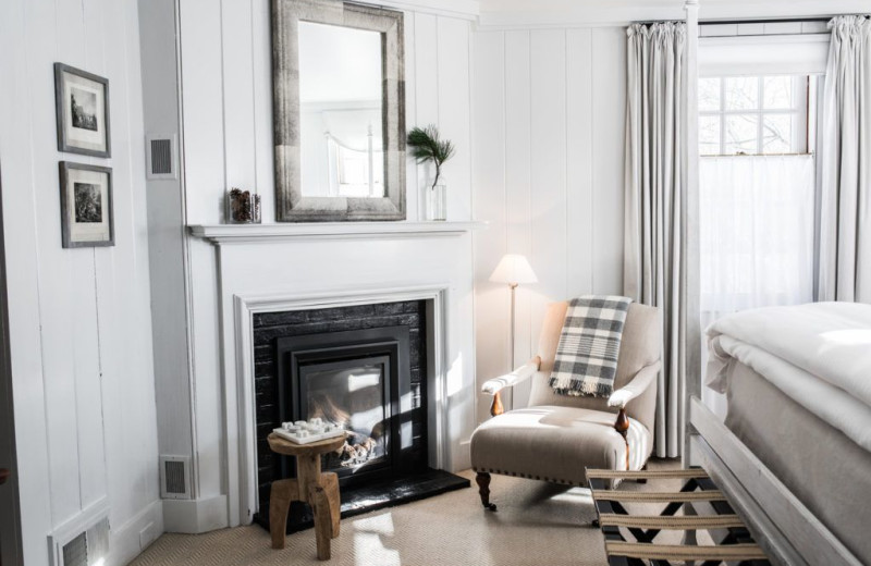 Guest room with gas fireplace at Edson Hill.