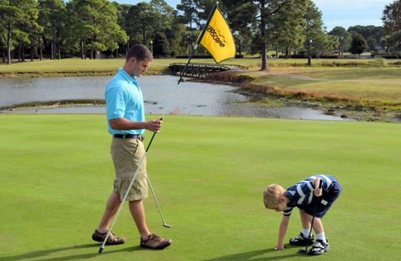 Family playing golf at Seascape Resort.