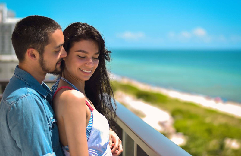Couple at The Alexander All Suite Oceanfront Resort.