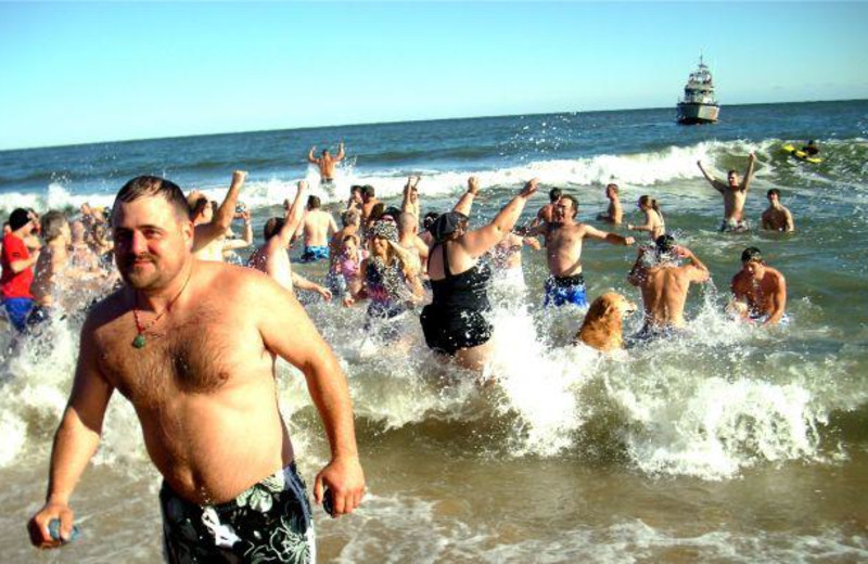 Swimming in the ocean at Hilton Suites Ocean City Oceanfront.