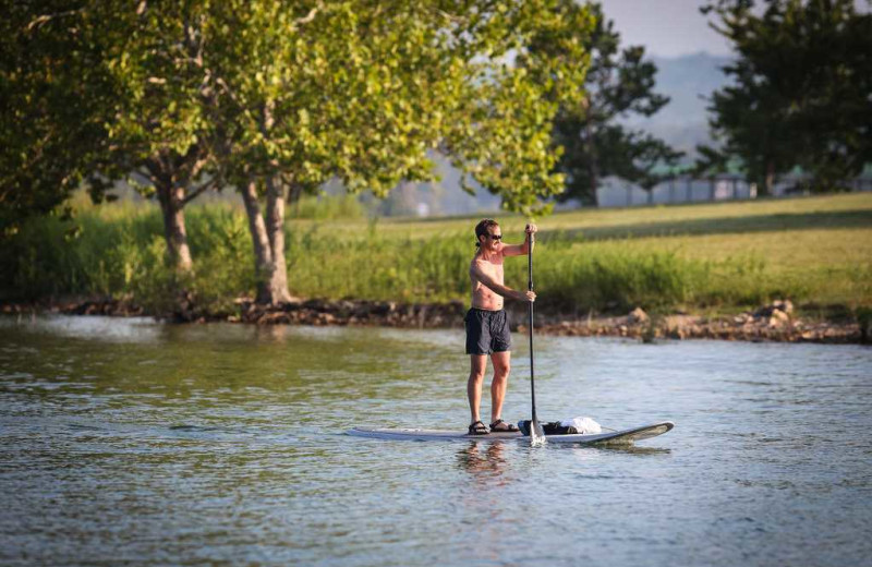 Paddle boarding at Branson Vacation Rentals.