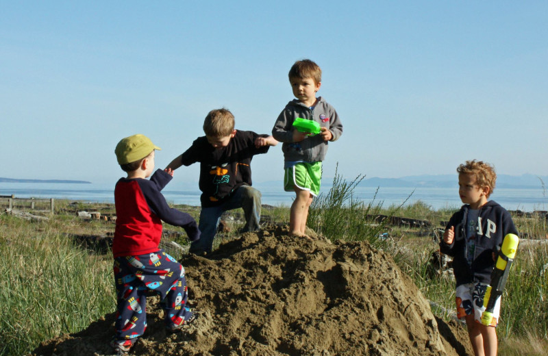 Children playing in the sand at The Shorewater Resort.