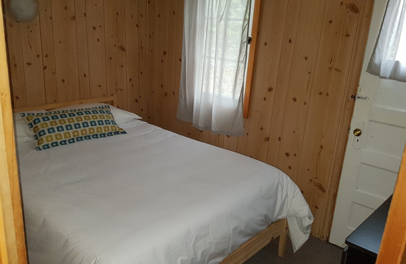 Cottage bedroom at Parkway Cottage Resort & Trading Post.