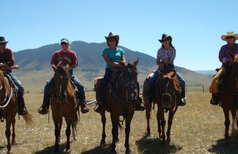 Group horseback riding at Vee Bar Guest Ranch.