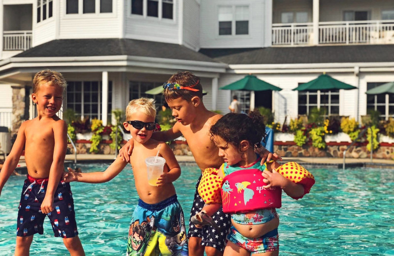 Kids at outdoor pool at The Osthoff Resort.