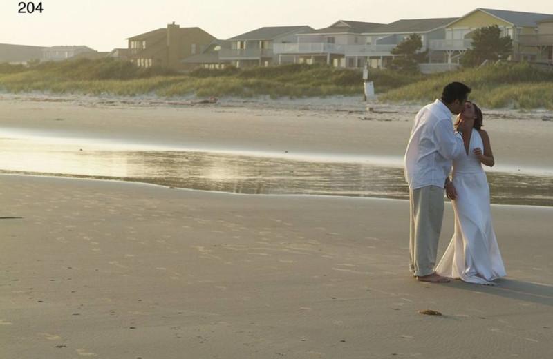 Wedding couple on beach at The Sunset Inn.