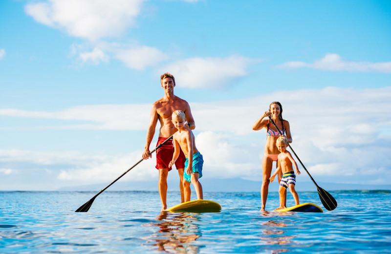 Family paddle board at Anna Maria Vacations.