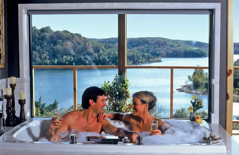 Couple in hot tub at Beaver Lakefront Cabins.