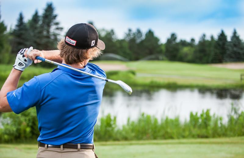 Playing golf at Evergreen Resort.
