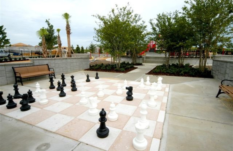 Giant chess at Elite Vacation Homes.