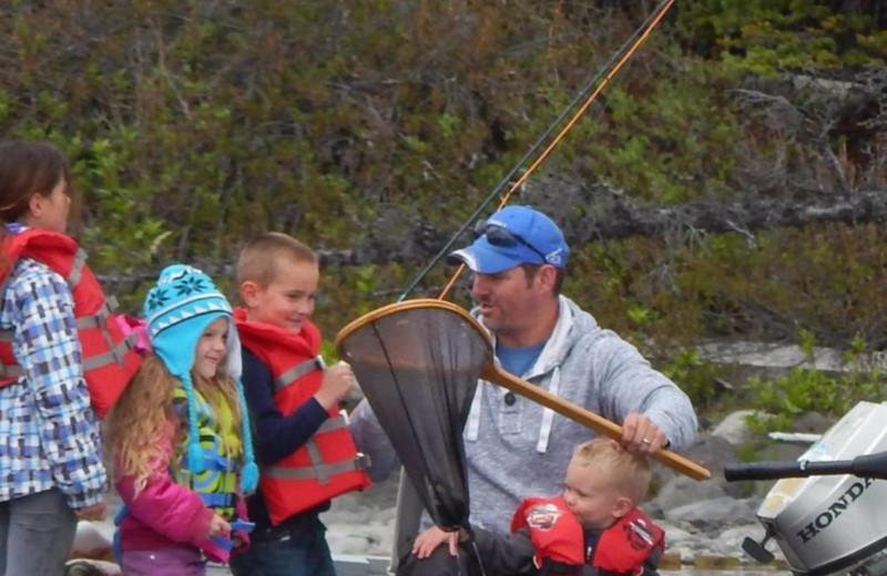 Family fishing at Chaunigan Lake Lodge.