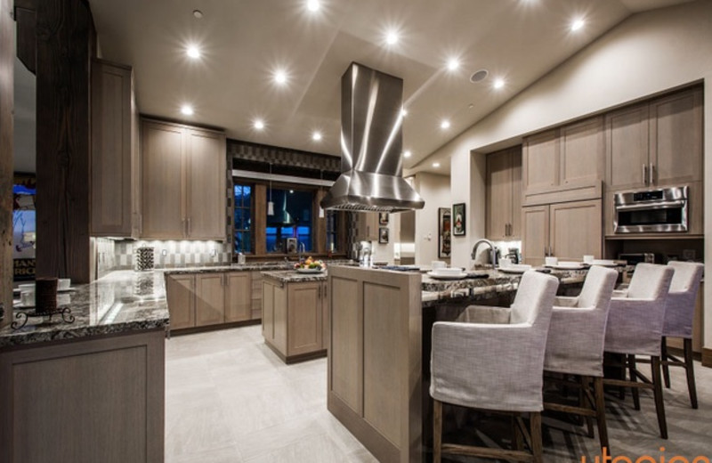 Rental kitchen at Utopian Luxury Vacation Homes.