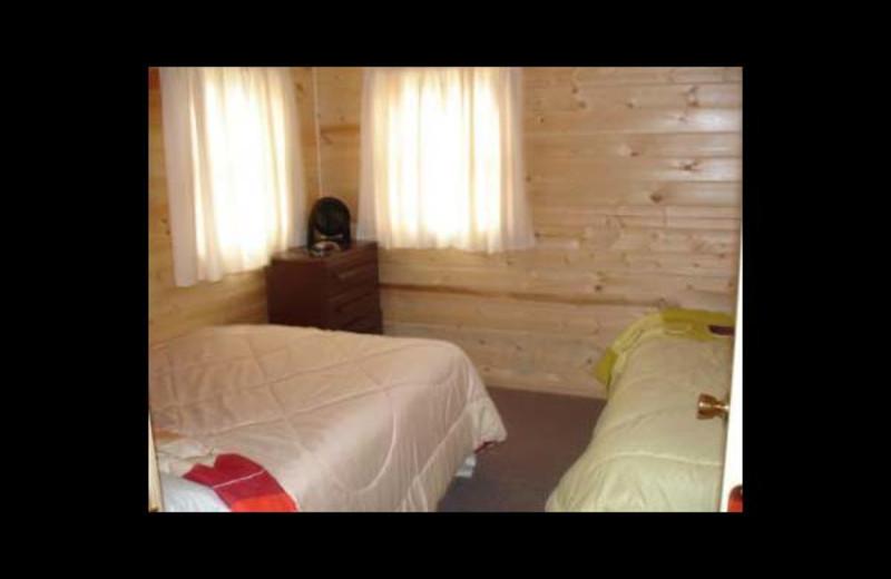 Cabin bedroom at Ward's Riverside Cabins.