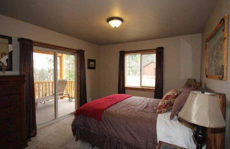 Cabin bedroom at Gentry River Ranch.