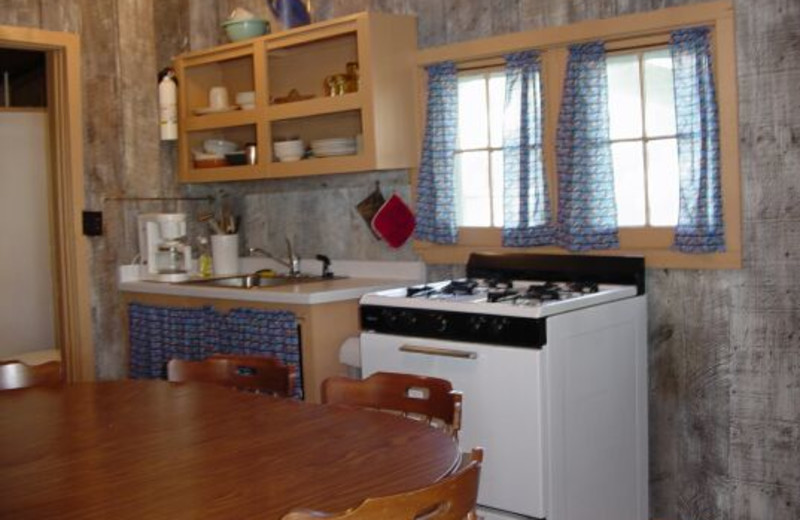 Cabin kitchen at Whispering Pines Resort.
