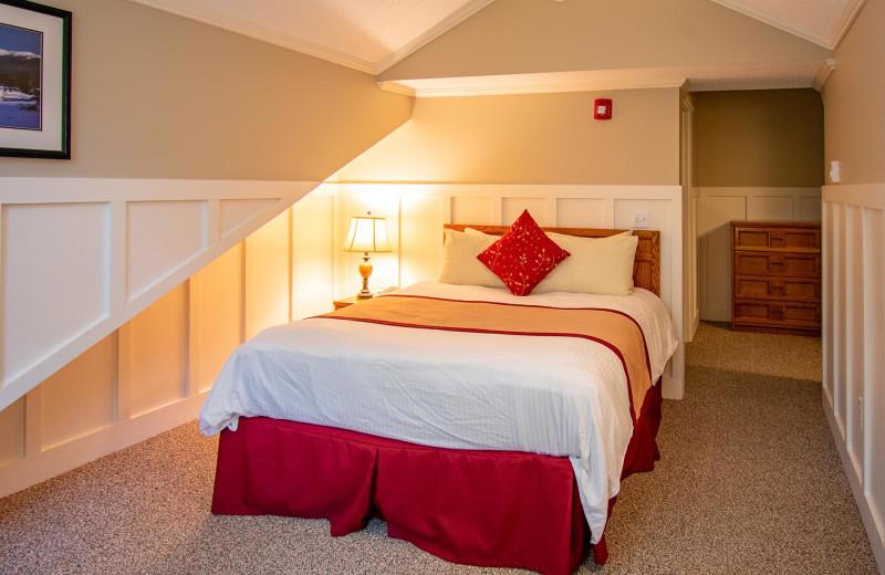 Guest bedroom at Attitash Mountain Village Resort.