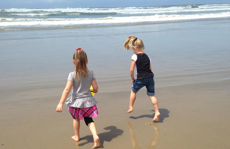 Kids running on beach at Driftwood Shores Resort and Conference Center.