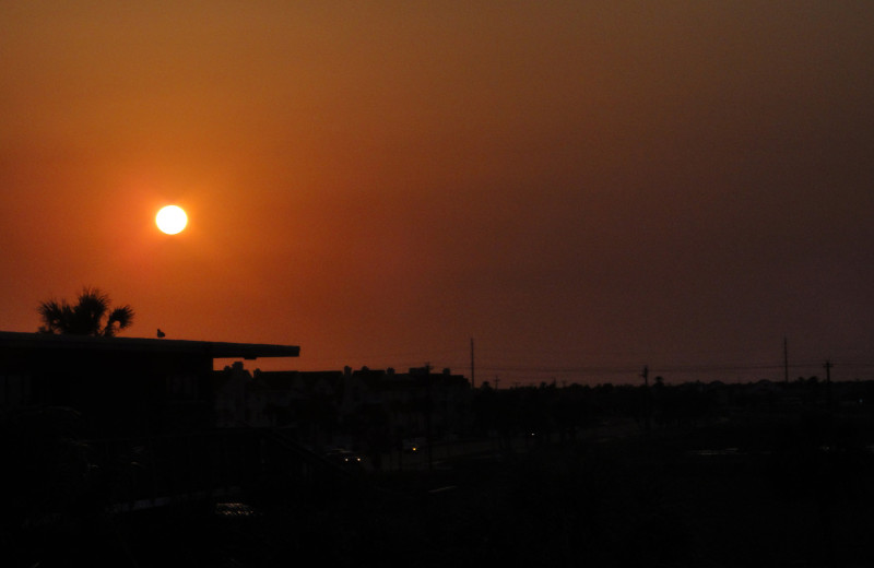 Sunsets by the beach at Island House Beach Front Condominiums