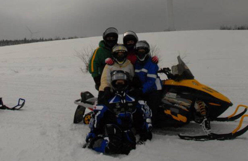 Family snowmobiling at S & J Lodge.