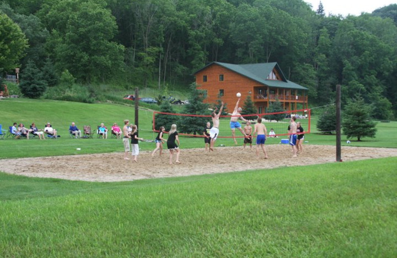 Family playing volleyball at Cedar Valley Resort.