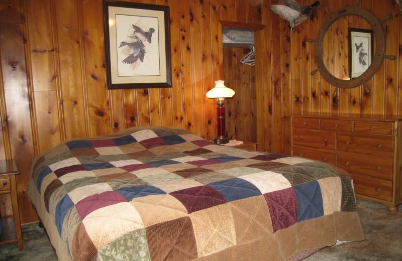 Cabin bedroom at Pine Tree Cove Resort.